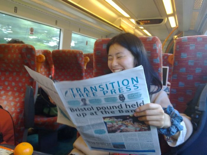 Mika reading the Transition Free Press