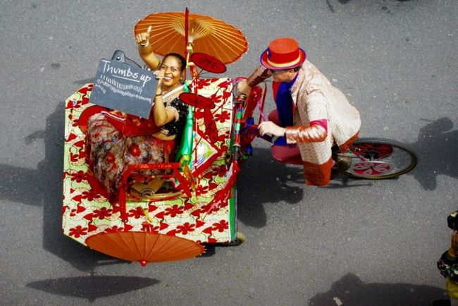 lady-in-rickshaw-from-above-july-3-650x434