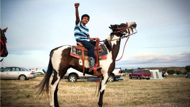 standing-rock-kid-with-fist_h_0-650x366