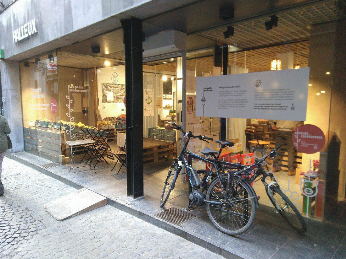 Bikes leaning on shop window